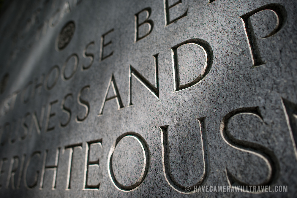 "Close-up of the word ""righteous"" inscribed into one of the four large tablets standing at the Theodore Roosevelt Memorial in Arlington, Virginia, just across the Potomac from the National Mall."