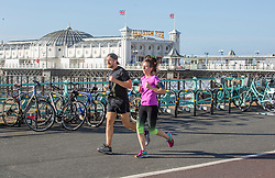 © Licensed to London News Pictures. 22/10/2017. Brighton, UK. Members of the public take advantage of the sunny weather to go for a run on the seafront in Brighton and Hove. Photo credit: Hugo Michiels/LNP