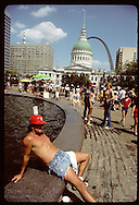 VP Fair celebrants relax around fountain in Kiener Plaza; Arch & Old Courthouse in background. Missouri