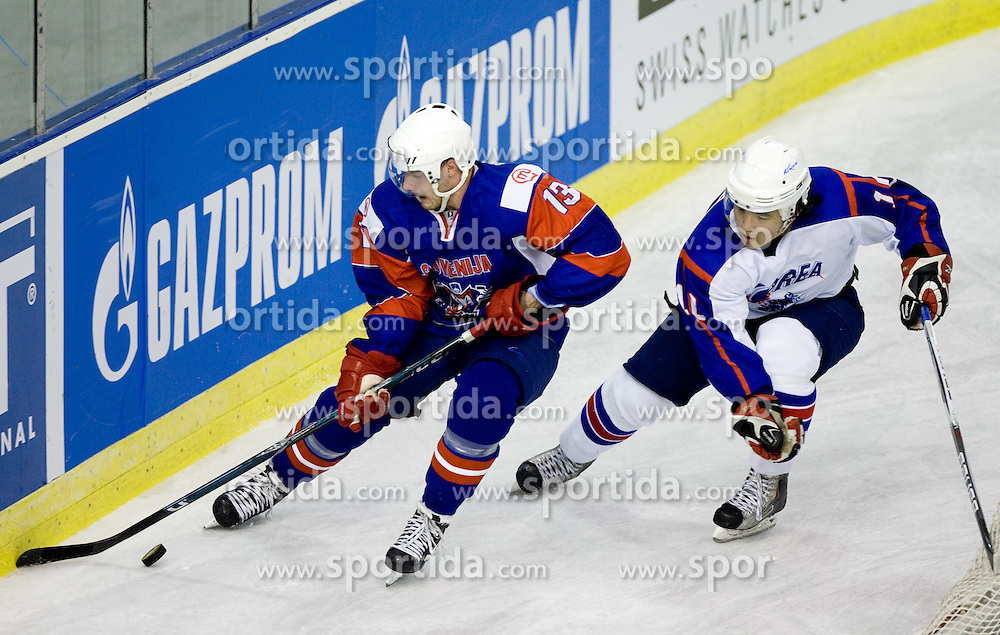 MURSAK Jan of Slovenia and YOON HWAN KIM of Korea at Round 4 of IIHF Ice-hockey World Championships Division I Group B match between National teams of Slovenia and South Korea, on April 21, 2010, in Tivoli hall, Ljubljana, Slovenia.  (Photo by Vid Ponikvar / Sportida)