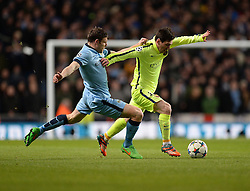 James Milner of Manchester City Battles for the ball with Lionel Messi of Barcelona - Photo mandatory by-line: Alex James/JMP - Mobile: 07966 386802 - 24/02/2015 - SPORT - Football - Manchester - Etihad Stadium - Manchester City v Barcelona - Champions League - Round of 16