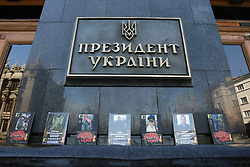 May 23, 2019 - Kyiv, Ukraine - The photographs of perished servicemen line the walls outside the Presidential Administration as widows hold a protest action against a referendum on making agreements with Russia over peace in Donbas, Kyiv, capital of Ukraine, May 23, 2019. Ukrinform. (Credit Image: © Ovsyannikova Yulia/Ukrinform via ZUMA Wire)