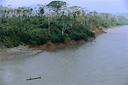 Machiguenga Indians in Canoe<br /> Timpia Community<br /> Lower Urubamba River. Amazon Rain Forest<br /> PERU.  South America