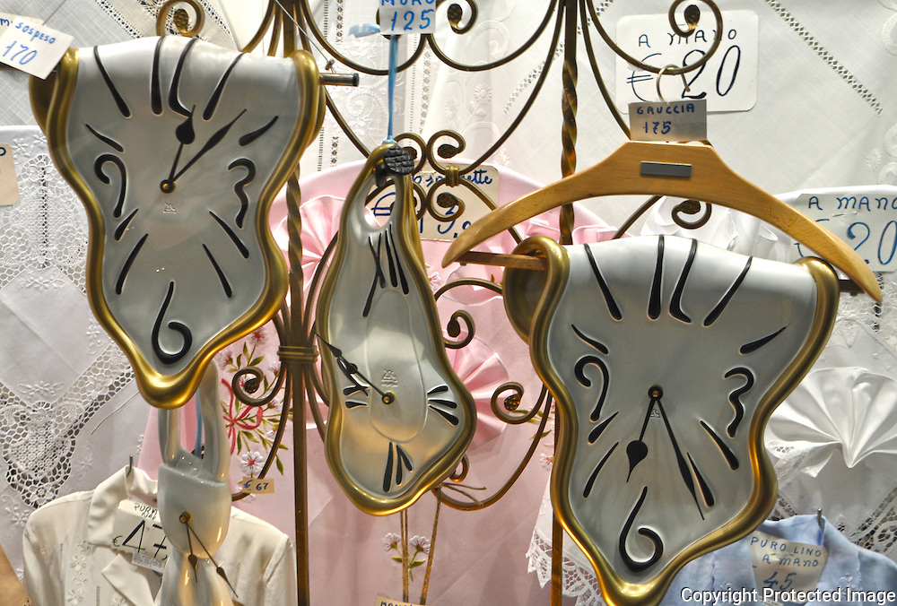 Close-up of the astonishing Dali melting clocks in a shop window in Venice, Italy.