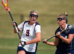 Virginia A Whitaker Hagerman (9) is defended by PSU M Mary Dean (11).  The #2 ranked Virginia Cavaliers women's lacrosse team defeated the Penn State Nittany Lions 12-11 in overtime at Klockner Stadium on the Grounds of the University of Virginia in Charlottesville, VA on March 7, 2009.