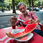 MILAN, ITALY - JULY 02:  Hot Weather in Milan with boys and girls playing in the fountain at Castello Sforzesco, pensioner enjoy watermelo, Ice Cream and relaxing in the shade on July 2, 2010 in Milan, Italy. Italy is experiencing a  week of very high summer temperatures. Discover Milan with a Photo Walk or Photo Tour by Award winner photographer Marco Secchi
