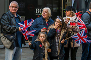 Watching the parade in Cheepside - The new Lord Mayor (Peter Estlin, the 691st) was sworn in yesterday. To celebrate, today is the annual Lord Mayor's Show. It includes Military bands, vintage buses, Dhol drummers, a combine harvester and a giant nodding dog in the three-mile-long procession. It brings together over 7,000 people, 200 horses and 140 motor and steam-driven vehicles in an event that dates back to the 13th century. The Lord Mayor of the City of London rides in the gold State Coach.