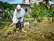 25 JUNE 2017 - BANGKOK, THAILAND: Women clean the grave of a loved one after Eid al-Fitr prayers. It's customary in Thailand to clean the graves of family members after Eid al-Fitr. Eid al-Fitr is also called Feast of Breaking the Fast, the Sugar Feast, Bayram (Bajram), the Sweet Festival or Hari Raya Puasa and the Lesser Eid. It is an important Muslim religious holiday that marks the end of Ramadan, the Islamic holy month of fasting. Muslims are not allowed to fast on Eid. The holiday celebrates the conclusion of the 29 or 30 days of dawn-to-sunset fasting Muslims do during the month of Ramadan. Islam is the second largest religion in Thailand. Government sources say about 5% of Thais are Muslim, many in the Muslim community say the number is closer to 10%.    PHOTO BY JACK KURTZ