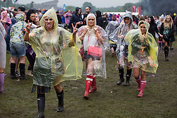 © Licensed to London News Pictures . 07/06/2014 . Heaton Park , Manchester , UK .Revellers traipse through rain and mud . The Parklife music festival in Heaton Park Manchester following heavy overnight rain . Photo credit : Joel Goodman/LNP