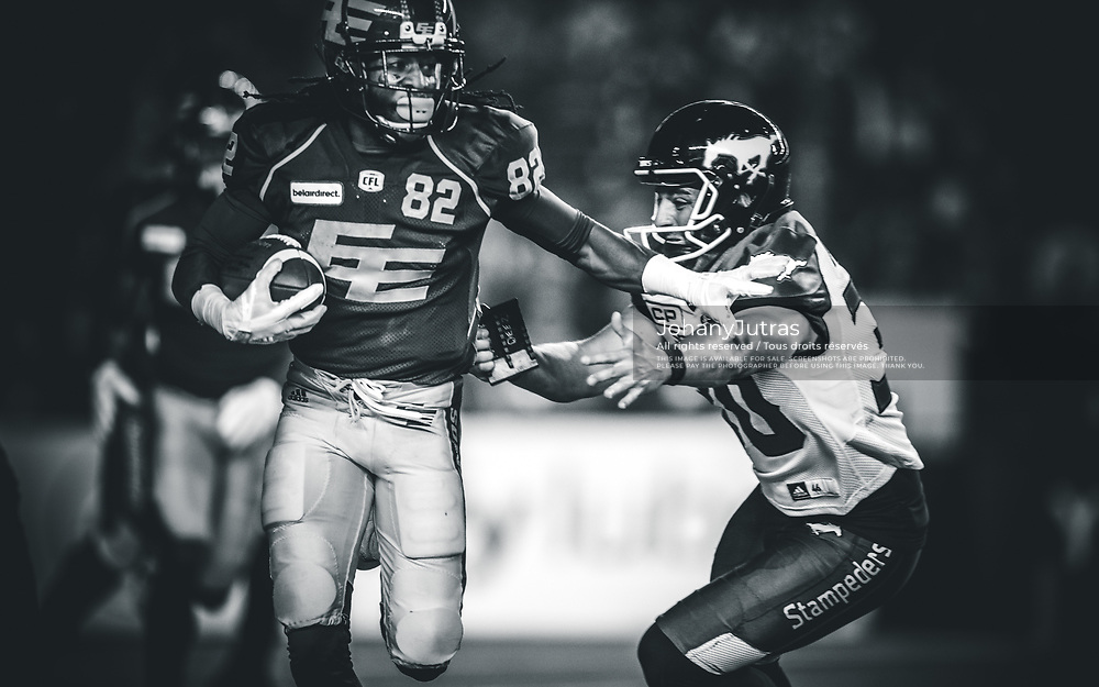 Jamill Smith (82) of the Edmonton Eskimos and Rene Paredes (30) of the Calgary Stampeders during the game at Commonwealth Stadium in Edmonton AB, Saturday, September 9, 2017. (Photo: Johany Jutras)
