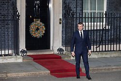 London, UK. 3 December, 2019. French President Emmanuel Macron arrives at 10 Downing Street for a meeting with Turkish President Recep Tayyip Erdoğan hosted by Prime Minister Boris Johnson and German Chancellor Angela Merkel to discuss the ongoing dispute between the two Presidents following the Turkish invasion of Kurdish-controlled areas of northern Syria.