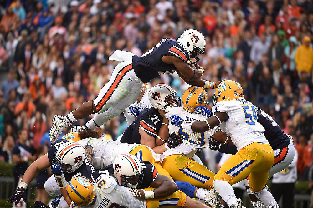 Peyton Barber (25) goes over the top for one of his five touchdowns. <br /> San Jose State Spartans vs. Auburn Tigers at Jordan-Hare Stadium in Auburn, Ala. on Saturday, Oct. 3, 2015.<br /> Zach Bland/Auburn Athletics