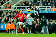 DeAndre Yedlin (#22) of Newcastle United leaps to volley the ball clear under pressure from Alexis Sanchez (#7) of Manchester United during the Premier League match between Newcastle United and Manchester United at St. James's Park, Newcastle, England on 2 January 2019.