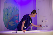 A midwife fills the birthing pool in the midwife led birth centre, Chelsea and Westminster Hospital, London.
