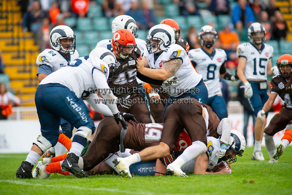 KELOWNA, BC - SEPTEMBER 8:  Aiden Hennessey #45 and Dawson Puk #49 of Okanagan Sun bring down the Langley Rams at the Apple Bowl on September 8, 2019 in Kelowna, Canada. (Photo by Marissa Baecker/Shoot the Breeze)