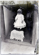 little toddler in door opening on a severely eroding glass plate