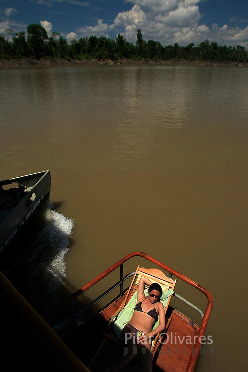 People travel on the Delfin I luxury cruise across the Maranon river at Peru's Pacaya Samiria National Reserve in the Amazon jungle, September 4, 2011. REUTERS/Pilar Olivares....