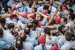 November 20, 2016 - Barcelona, Catalonia, Spain - The 'Castellers de poble Sec' organize the base of a human tower during a 'diada castellera' at Barcelona's Gracia quarter (Credit Image: © Matthias Oesterle via ZUMA Wire)