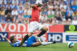 WIGAN, ENGLAND - Sunday, May 11, 2008: Manchester United's Carlos Tevez and Wigan Athletic's Michael Brown during the final Premiership match of the season at the JJB Stadium. (Photo by David Rawcliffe/Propaganda)