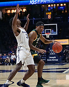 Manny Camper (3) of Siena drives past Quentin Goodin (3) of Xavier during an NCAA college basketball game, Friday, Nov. 8, 2019, at the Cintas Center in Cincinnati, OH. Xavier defeated Siena 81-63. (Jason Whitman/Image of Sport)