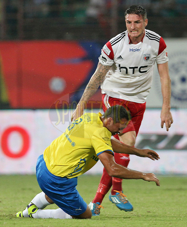 James Keene of NorthEast United FC pushes Michael Chopra of Kerala Blasters FC during match 49 of the Hero Indian Super League between Kerala Blasters FC and North East United FC held at the Jawaharlal Nehru Stadium, Kochi, India on the 4th December 2014.<br /> <br /> Photo by:  Vipin Pawar/ ISL/ SPORTZPICS