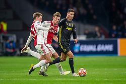 10-04-2019 NED: Champions League AFC Ajax - Juventus,  Amsterdam<br /> Round of 8, 1st leg / Ajax plays the first match 1-1 against Juventus during the UEFA Champions League first leg quarter-final football match / Frenkie de Jong #21 of Ajax, Matthijs de Ligt #4 of Ajax, Cristiano Ronaldo #7 of Juventus