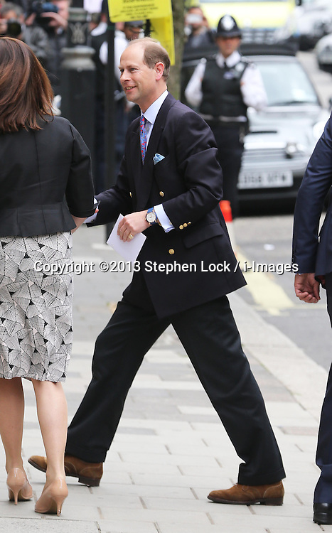 Earl of Wessex carrying a card as he arrives to visit his father the Duke of Edinburgh at The London Clinic as spends his 92nd birthday in hospital in London, Monday, 10th June 2013<br /> Picture by Stephen Lock / i-Images