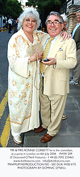 MR & MRS RONNIE CORBETT he is the comedian, at a party in London on 6th July 2004.PWW 209