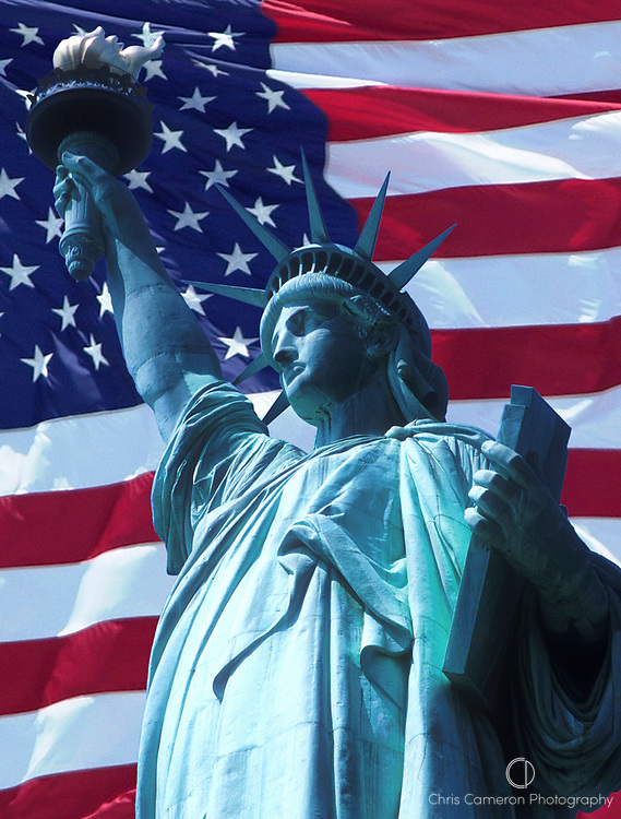Statue of Liberty against Stars and Stripes, flag of the United States of America. (photomontage 5/4/2003)