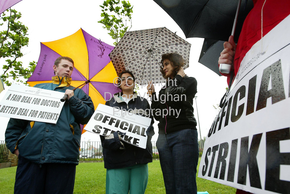 8/8/2002.From right Finbar O Leary, Nazly Alansari and Navreet Pannu pictured at the picket at Waterford Regional Hospital yesterday..Picture Dylan Vaughan