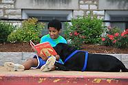 05: SCHOOLS READING BOYS & DOG