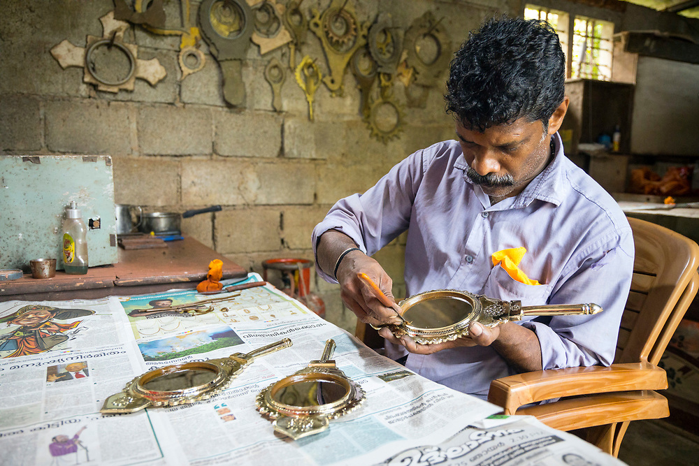 ARANMULA, INDIA - 16th September 2019 - The Aranmula Kannadi - or the Aranmula metal mirror - is made of metal, not glass. It is a marvel in the annals of metallurgy and has been used long before the appearance of the modern silicone synthetic glass mirror. Images are reflected with complete clarity without any refraction, unlike a glass mirror where images fall on the mercury coated surface inside the glass. Blending copper and tin to produce a distortion free mirror is an artisinal technique that has long been practised in various parts of the old world. The ancient art is still practised by a handful of family artisans in Aranmula, Kerala, Southern India.