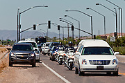 04 AUGUST 2010 -- GILBERT, AZ: Motorists pull off of Elliot as the funeral procession at the funeral for Chandler police detective Carlos Ledesma passes Wednesday. Ledesma was killed during a shoot out with suspected drug dealers during an undercover operation in south Phoenix Wednesday July 28.  PHOTO BY JACK KURTZ