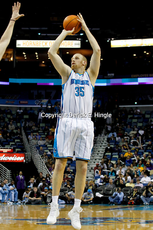 January 18, 2012; New Orleans, LA, USA; New Orleans Hornets center Chris Kaman (35) against the Memphis Grizzlies during the first half of a game at the New Orleans Arena.   Mandatory Credit: Derick E. Hingle-US PRESSWIRE