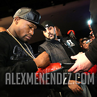 Floyd Mayweather signs autographs during Showtime Televisions ShoBox:The Next Generation boxing match at the Event Center at Turning Stone Resort Casino on Friday, February 28, 2014 in Verona, New York.  (AP Photo/Alex Menendez)