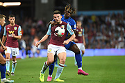 Aston Villa midfielder John McGinn (7) battles for possession with Everton forward Moise Kean (27) during the Premier League match between Aston Villa and Everton at Villa Park, Birmingham, England on 23 August 2019.