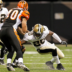 2009 August 14: New Orleans Saints cornerback Randall Gay (20) attempts to tackle Cincinnati Bengals running back Brian Leonard (40) during a preseason opener between the Cincinnati Bengals and the New Orleans Saints at the Louisiana Superdome in New Orleans, Louisiana.