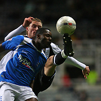 Photo: Andrew Unwin.<br /> Newcastle United v Birmingham City. The FA Cup. 17/01/2007.<br /> Newcastle's Alan O'Brien competes with Birmingham's Bruno N'Gotty.