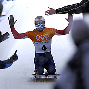 With his coach giving the sign that he is number one Jim Shea crosses into the finish area to win the gold medal in the mens Skeleton at Utah Winter Sports Park in Park City, Utah Wednesday Feb. 20, 2002 at the 2002 Winter Olympic Games. Photo by August Miller.