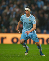 MANCHESTER, ENGLAND - Sunday, January 8, 2012: Manchester City's Stefan Savic, with a bandaged head, in action against Manchester United during the FA Cup 3rd Round match at the City of Manchester Stadium. (Pic by David Rawcliffe/Propaganda)