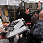 """June 21, 2014 - New York, NY : <br /> The city was flooded with music on Saturday as Make Music New York brought more than 1,300 free concerts to the city's streets and parks. The annual festival's program included the performance """"'In (Key)' - New Compositions in Celebration of Terry Riley's 'In C' @ 50 Years"""" on Cornelia Street, in front of the Cornelia Street Cafe in Greenwich Village, on Saturday afternoon. Pictured here, the musicians, including Patrick Grant, center, perform a piece by Grant. Grant was also one of the organizers of the event. <br /> CREDIT: Karsten Moran for The New York Times"""
