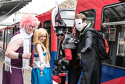 Cosplay enthusiasts travelling on the DLR to the MCM London Comic Con at the Excel centre.