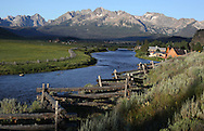 The sun rises on the Sawtooth Mountains and the Salmon River in central Idaho near the town of Stanley.