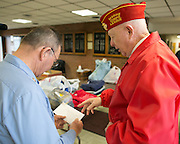 Jim Emerson, right, drops off gift cards with James Lechner at Chili Fire Department on Saturday, November 8, 2014. The New York Warrior Alliance's donation drive aims to collect new clothing and other items for wounded veterans and their families.