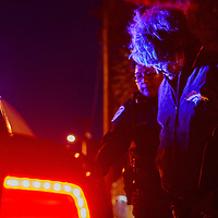 Gallup police escort a subject into a police cruiser at the scene of a narcotics raid in near Second Street and Adams Avenue in Gallup Tuesday.