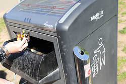 Solar powered waste bin which periodically compresses its contents so it does not need emptying so frequently.