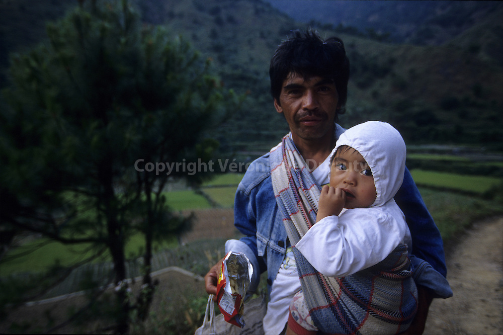 FATHER AND HIS BABY ON THE PATH NEAR KABAYAN VILLAGE IN THE CORDILLERA, LUZON ISLAND, THE PHILIPPINES