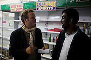 Stern writer Markus Goetting interviewing looted store owner Siva Kandiah in Hackney, London. After the riots of London and other UK cities, Sri Lankan-born Sivaharan (Siva) Kandiah in his looted shop 'Clarence Convenience Store' in Clarence Road, Hackney.