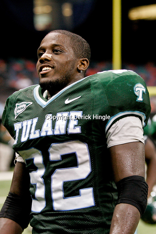 Sep 26, 2009; New Orleans, LA, USA;  Tulane Green Wave running back Andre Anderson (32) celebrates after the game against the McNesse State Cowboys at the Louisiana Superdome. Tulane defeated McNeese State 42-32. Mandatory Credit: Derick E. Hingle-US PRESSWIRE