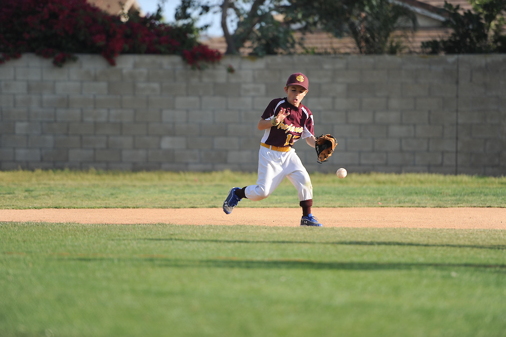 South Sunrise Little League Trojans defeat the Titans 14-13.<br /> <br /> <br /> ///ADDITIONAL INFO:   <br /> <br /> 2016.SSLL.0414.kjs_trojans_game  ---  Photo by Kevin Sullivan Team Photography   --  4/14/16<br /> <br /> <br /> 4/14/16
